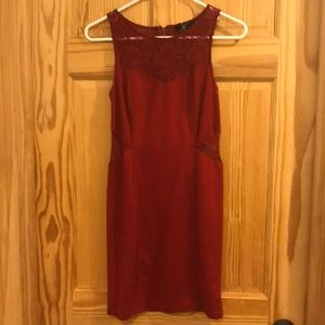 Cute deep red body con dress with lace cutouts